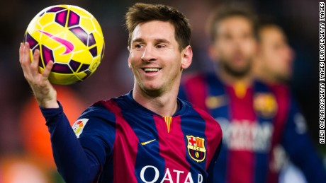 BARCELONA, SPAIN - DECEMBER 07: Lionel Messi of FC Barcelona with the match ball after scoring three goals during the La Liga match between FC Barcelona and RCD Espanyol at Camp Nou on December 7, 2014 in Barcelona, Spain. (Photo by Alex Caparros/Getty Images)