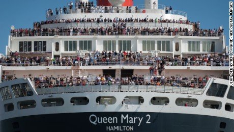 TOPSHOT - British cruise ship Queen Mary 2 arrives in Saint-Nazaire, western France on June 24, 2017, on the eve of the start of The Bridge 2017, a transatlantic race between The Queen Mary 2 and the world's fastest Ultim trimarans from Saint-Nazaire to New-York.  / AFP PHOTO / JEAN-SEBASTIEN EVRARD        (Photo credit should read JEAN-SEBASTIEN EVRARD/AFP/Getty Images)