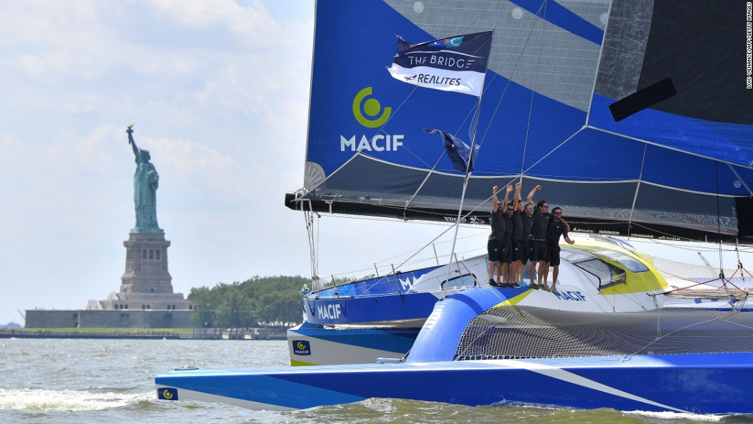 Gabart (C) celebrates with teammates on board Macif after passing under the Verrazano-Narrows Bridge finish line in New York. Macif completed the journey in eight days, 31 minutes and 20 seconds, sailing at an average speed of 18.61 knots.