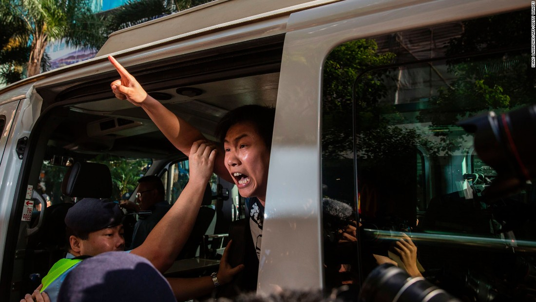 "Protester Raphael Wong is taken away by police during a demonstration in Hong Kong on Saturday, July 1. A flag-raising ceremony was taking place in the city to mark 20 years of Chinese rule. Chinese President Xi Jinping <a href=""http://www.cnn.com/2017/06/30/asia/hong-kong-china-handover/index.html"" target=""_blank"">made his first visit to Hong Kong</a> since he took power in Beijing in 2013, but he left before the start of the city's annual pro-democracy march."