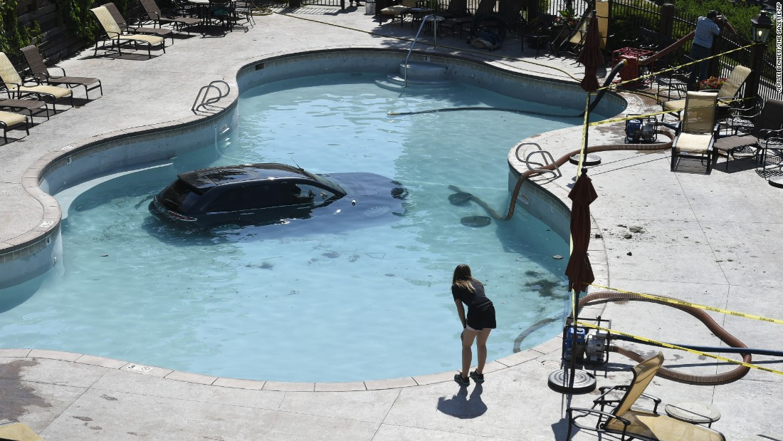 A 73-year-old woman escaped serious injury when she apparently mistook her gas pedal for the brake and drove her vehicle into this swimming pool in Colorado Springs, Colorado, on Monday, July 3. The pool was drained so the vehicle could be towed.