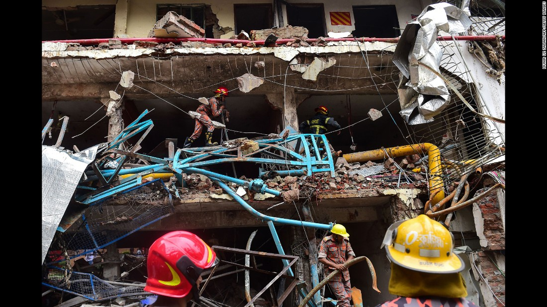 Firefighters take part in a search-and-rescue operation after a boiler explosion destroyed a garment factory in Gazipur, Bangladesh, on  Monday, July 3.