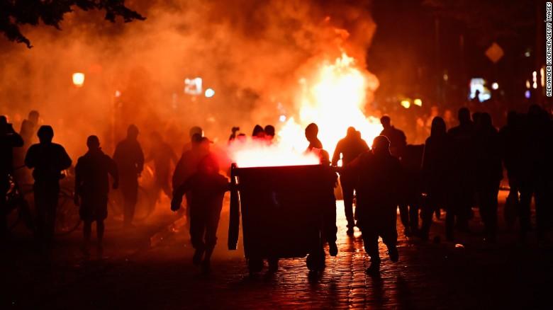 http://i2.cdn.cnn.com/cnnnext/dam/assets/170706180839-g20-hamburg-protest-street-fire-exlarge-169.jpg