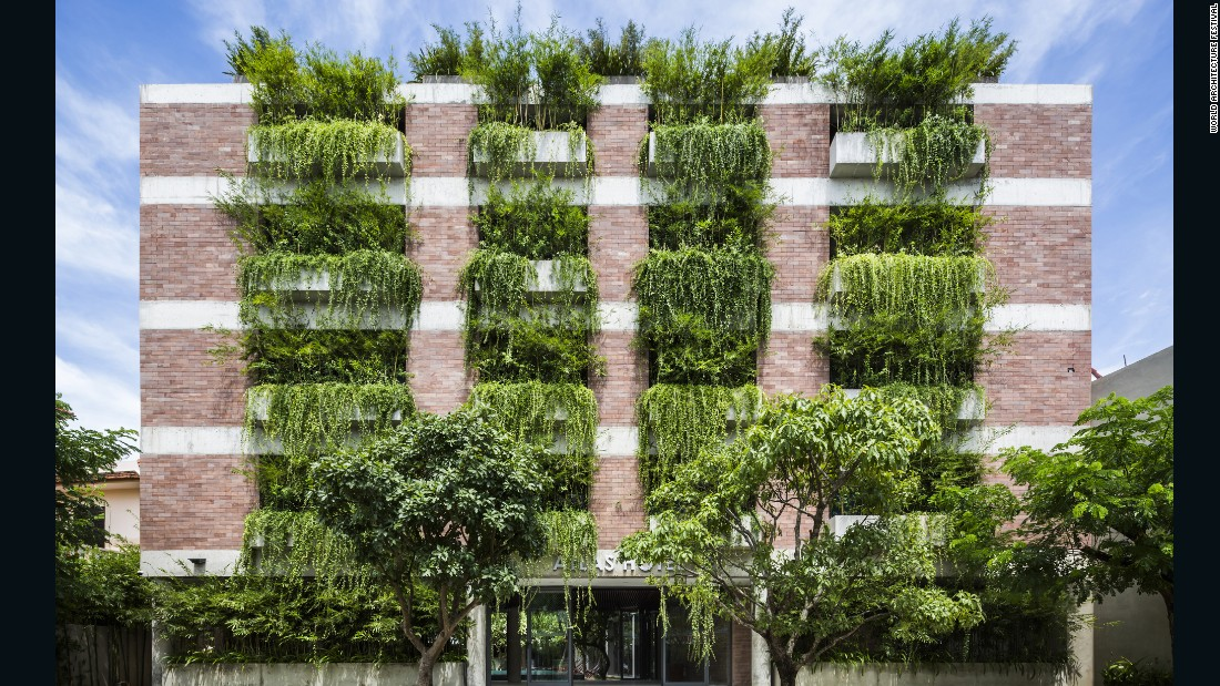 This hotel's exterior is made using locally-sourced sandstone. Plants help to improve ventilation and provide shade to the building's interior.