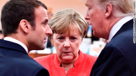 (L-R) French President Emmanuel Macron, German Chancellor Angela Merkel and US President Donald Trump confer at the start of the first working session of the G20 meeting in Hamburg, northern Germany, on July 7. Leaders of the world's top economies will gather from July 7 to 8, 2017 in Germany for likely the stormiest G20 summit in years, with disagreements ranging from wars to climate change and global trade. / AFP PHOTO / AFP PHOTO AND POOL / John MACDOUGALL        (Photo credit should read JOHN MACDOUGALL/AFP/Getty Images)