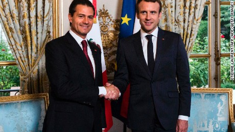 Mexico's President Enrique Pena Nieto (L) shakes hands with French President Emmanuel Macron prior to a meeting on July 6, 2017 at the Elysee Palace in Paris. / AFP PHOTO / POOL / Etienne LAURENT        (Photo credit should read ETIENNE LAURENT/AFP/Getty Images)