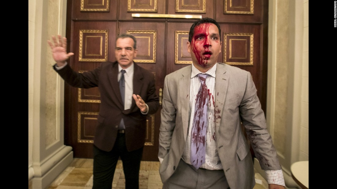 "Venezuelan lawmakers Luis Stefanelli, left, and Jose Regnault appear stunned in a corridor of the National Assembly after <a href=""http://www.cnn.com/2017/07/05/americas/venezuela-indepedence-day-clashes/index.html"" target=""_blank"">a clash with demonstrators</a> in Caracas on Wednesday, July 5. Supporters of Maduro stormed the building and attacked opposition lawmakers, witnesses said. At least seven legislative employees and five lawmakers were injured, according to National Assembly President Julio Borges. Journalists said they were also assaulted."