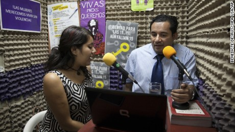 Dennis Muñoz, a lawyer working with rights groups to free women in prison on abortion charges, talks during a radio program.