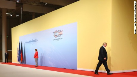 U.S. President Donald Trump, right, leaves the welcoming ceremony with German chancellor Angela Merkel, left, at the G-20 summit in Hamburg, Germany, Friday, July 7, 2017.  (Christian Charisius/dpa via AP)