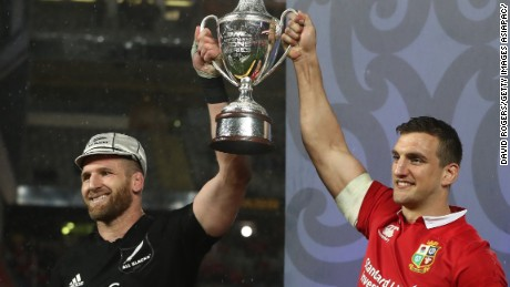 Opposing captains Kieran Read of the All Blacks and Sam Warburton of the Lions lift the trophy following a tied series after 15-15 draw in the third and final Test in Auckland.