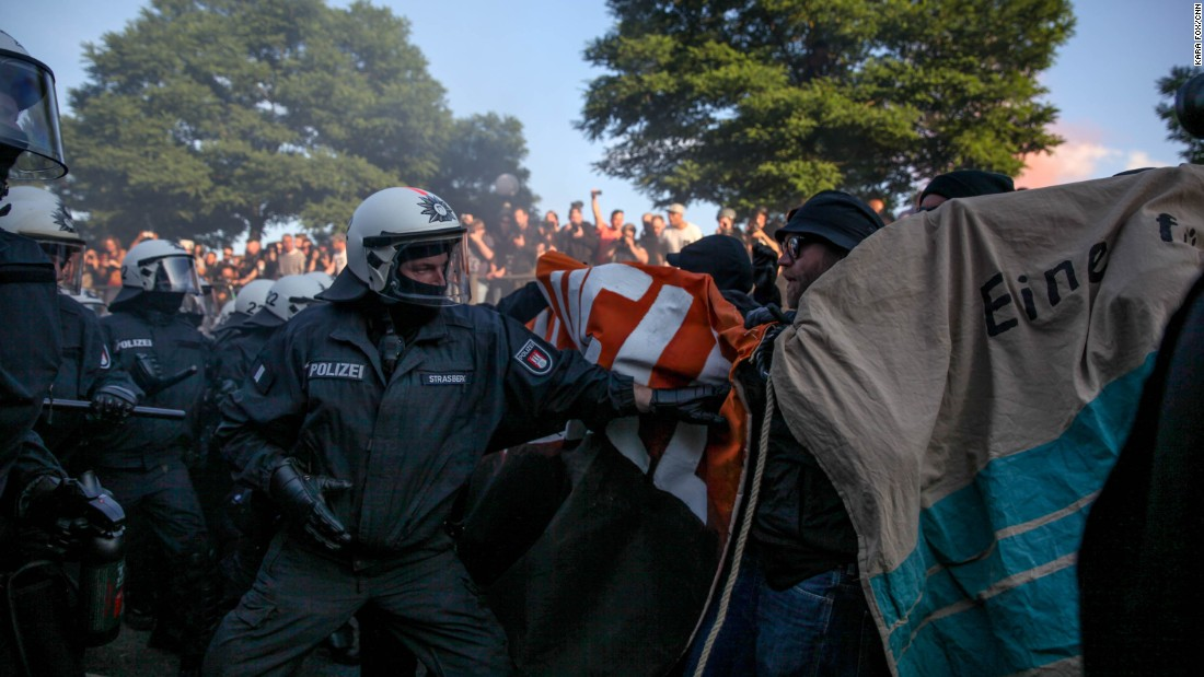"Clashes between riot police and demonstrators started shortly after the ""Welcome to Hell"" rally began on Thursday evening."