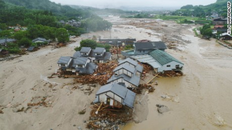 Houses are collapsed and half-buried in the mud following the flooding caused by heavy rain in Asakura, Fukuoka prefecture, southwestern Japan, Friday, July 7, 2017.
