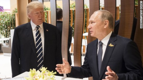HAMBURG, GERMANY - JULY 07: In this photo provided by the German Government Press Office (BPA), Donald Trump, President of the USA (C) meets Vladimir Putin, President of Russia during the G20 Summit on July 7, 2017 in Hamburg, Germany. The G20 group of nations are meeting July 7-8 and major topics will include climate change and migration.  (Photo by BPA via Getty Images)