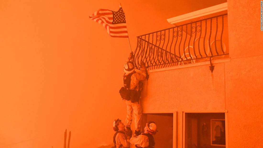 Surrounded by flames, California firefighters rescue US flag from wildfire