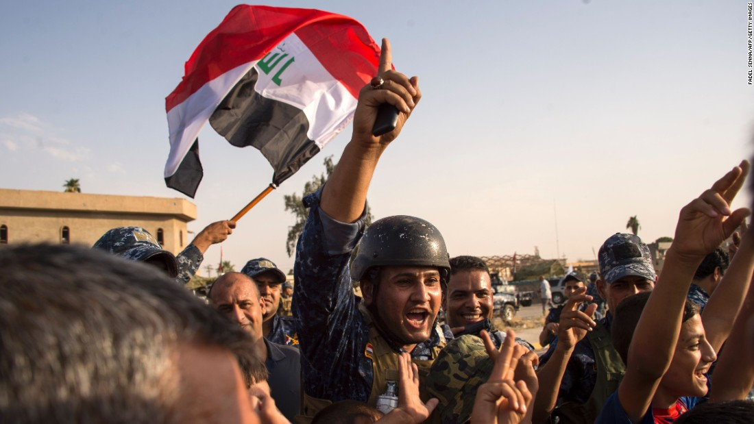 "Members of the Iraqi federal police wave the country's flag as they celebrate in the Old City of Mosul on Sunday, July 9. <a href=""http://www.cnn.com/2017/07/09/middleeast/iraq-mosul-victory-claimed/index.html"" target=""_blank"">Iraq declared victory against ISIS forces in Mosul </a>after a grueling monthslong campaign. The battle to reclaim Mosul, the last major ISIS stronghold in Iraq, has been underway since fall 2016."
