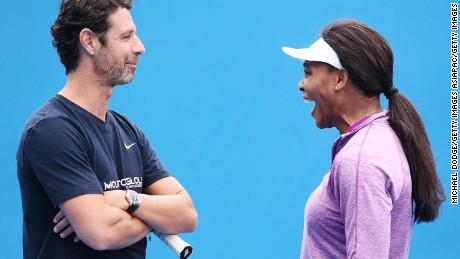 Mouratoglou and Serena share a joke.