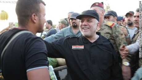 Iraqi Prime Minister Haidar al-Abadi visiting the governor of Mosul and walking through eastern Mosul streets and meeting residents.