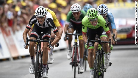 TOPSHOT - France's Warren Barguil (L) and Colombia's Rigoberto Uran (R) cross the finish line at the end of the 181,5 km ninth stage of the 104th edition of the Tour de France cycling race on July 9, 2017 between Nantua and Chambery. / AFP PHOTO / Jeff PACHOUD        (Photo credit should read JEFF PACHOUD/AFP/Getty Images)