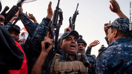 "Members of the Iraqi federal police forces celebrate in the Old City of Mosul on July 10, 2017 after the government's announcement of the ""liberation"" of the embattled city from Islamic State (IS) group fighters. Iraqi Prime Minister Haider al-Abadi's office said he was in ""liberated"" Mosul to congratulate ""the heroic fighters and the Iraqi people on the achievement of the major victory""."