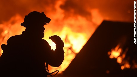 Red flag warnings as wildfires continue to burn
