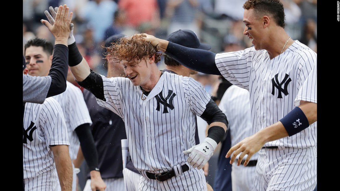 Clint Frazier is congratulated by his New York Yankees teammates after hitting a walk-off home run against Milwaukee on Saturday, July 8.