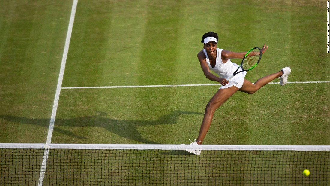 Venus Williams hits a shot during her third-round match at Wimbledon on Friday, July 7. She defeated Naomi Osaka 7-6, 6-4.