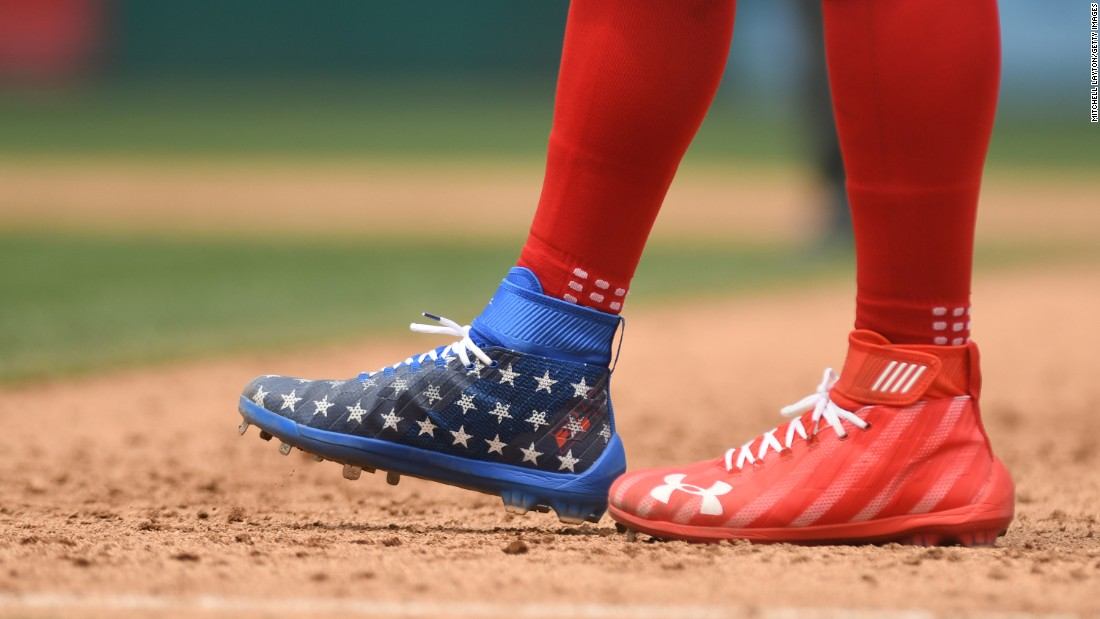 Baseball star Bryce Harper wears patriotic cleats at a Washington Nationals game on the Fourth of July.