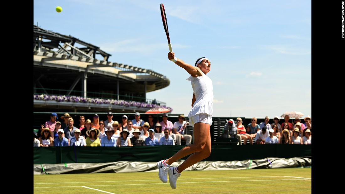 Caroline Garcia stretches for a backhand shot during her third-round match at Wimbledon on Friday, July 7. Garcia advanced with a 6-4, 6-3 victory over Madison Brengle.