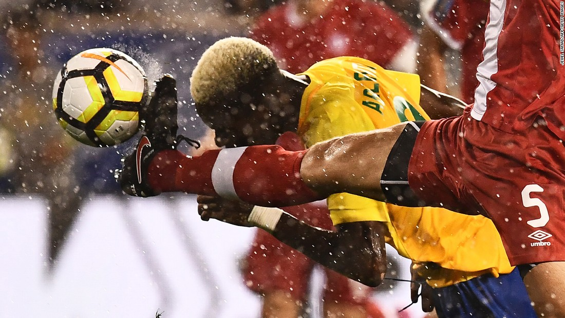 Canada's Dejan Jakovic, in red, competes for the ball with French Guiana's Arnold Abelinti during a Gold Cup match in Harrison, New Jersey, on Friday, July 7.