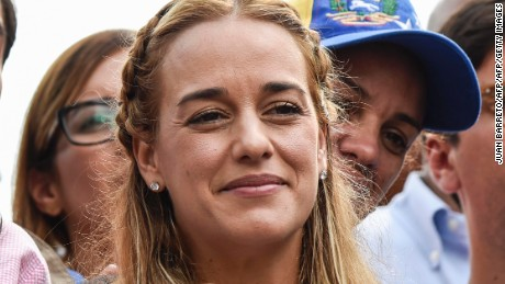 Lilian Tintori (L), wife of Venezuelan political prisoner and opposition leader Leopoldo Lopez, takes part in a demonstration marking 100 days of protests against President Nicolas Maduro in Caracas, on July 9, 2017. Venezuela hit its 100th day of anti-government protests on Sunday, one day after its most prominent political prisoner, Leopoldo Lopez, vowed to continue his fight for freedom after being released from jail and placed under house arrest. At least 91 people have died since non-stop street protests began on April 1. / AFP PHOTO / Juan BARRETO        (Photo credit should read JUAN BARRETO/AFP/Getty Images)