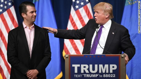 "LAS VEGAS, NV - FEBRUARY 23:  Donald Trump Jr. (L) looks on as his father, Republican presidential candidate Donald Trump, speaks at a caucus night watch party at the Treasure Island Hotel & Casino on February 23, 2016 in Las Vegas, Nevada. The New York businessman won his third state victory in a row in the ""first in the West"" caucuses.  (Photo by Ethan Miller/Getty Images)"