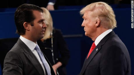 ST LOUIS, MO - OCTOBER 09:  Donald Trump, Jr. (L) greets his father Republican presidential nominee Donald Trump during the town hall debate at Washington University on October 9, 2016 in St Louis, Missouri. This is the second of three presidential debates scheduled prior to the November 8th election.  (Photo by Saul Loeb-Pool/Getty Images)