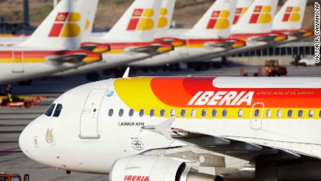 File - In this Nov. 12, 2009 file photo, Iberia planes are seen parked-up at Barajas airport in Madrid. Qatar Airways announced Friday, Jan. 30, 2015, that it has bought nearly 10 percent of the parent company of British Airways and Spain's Iberia, deepening wealthy Qatar's business ties to Europe and intensifying competition with the airline's fast-growing Gulf rivals. (AP Photo/Victor R. Caivano, File)