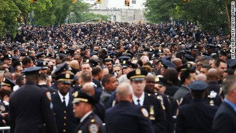 Thousands of police officers, some from as far away as Canada and Los Angeles, attend slain officer's funeral.