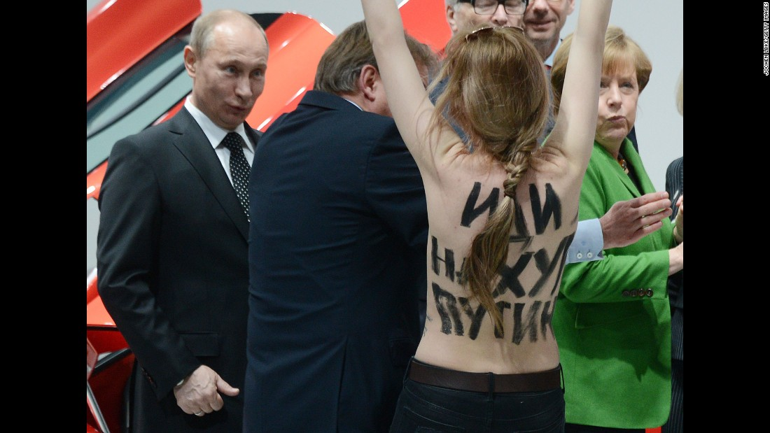 "A topless protester shouts at Putin and German Chancellor Angela Merkel during a visit to central Germany in April 2013. That month, Putin <a href=""http://www.cnn.com/2013/04/25/world/europe/russia-putin-questions/index.html"" target=""_blank"">defended his government's record on free speech</a> and rejected a claim that it uses ""Stalinist"" methods to clamp down on critics and activists. Two international rights groups had issued scathing reports on Putin's presidency, saying changes to the law had helped authorities stifle dissent."