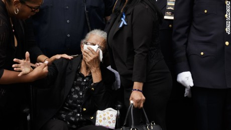Adriana Valoy, the mother of New York City police officer Miosotis Familia, cries as her daughter's casket is carried away outside of the World Changers Church in the Bronx.
