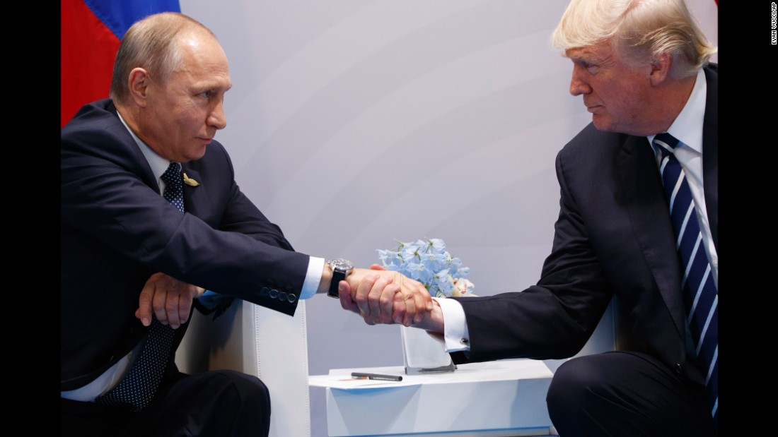 "Putin shakes hands with US President Donald Trump <a href=""http://www.cnn.com/2017/07/07/politics/trump-putin-meeting/index.html"" target=""_blank"">as they meet on the sidelines</a> of the G20 summit in Germany on Friday, July 7. They talked for more than two hours, discussing interference in US elections and ending with an agreement on curbing violence in Syria."