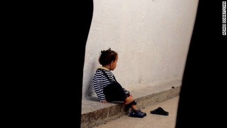 The daughter of an ISIS bride sits on her own in the jail.