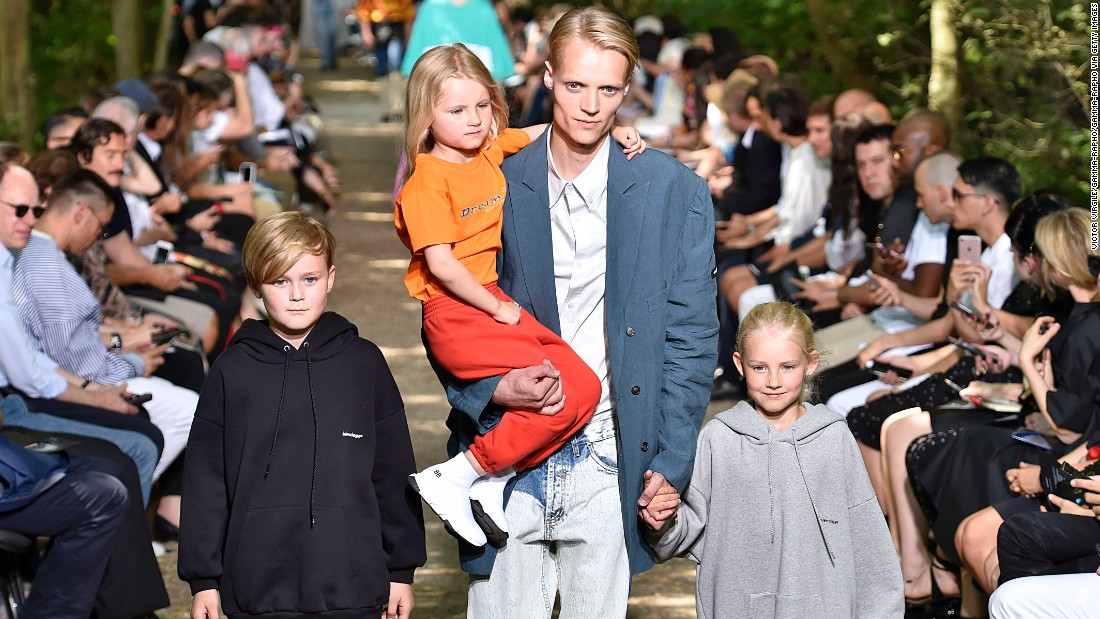 Demna Gvasalia's latest Balenciaga show featured real families clad in hoodies and blazers.
