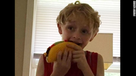 10-year old Vincent Lamon pretends to eat his yarn taco.
