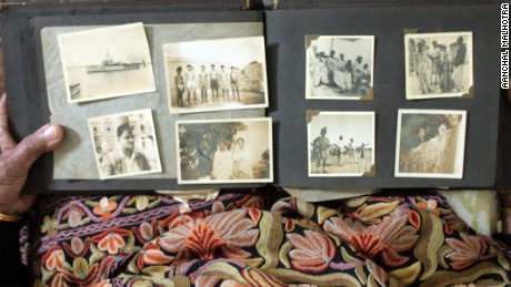 Photographs carried from Aligarh to Karachi.