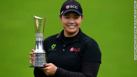 WOBURN, ENGLAND - JULY 31:  Ariya Jutanugarn of Thailand poses with the trophy following her victory during the final round of the Ricoh Women's British Open at Woburn Golf Club on July 31, 2016 in Woburn, England.  (Photo by Tony Marshall/Getty Images)