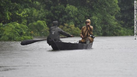 Indian forest guard patroll on a boat A flooded area at Kaziranga National Park, about 250 kilometres east of Guwahati, on July 10, 2017