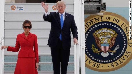 US President Donald Trump waves as he disembarks form Air Force One with First Lady Melania on July 13, 2017 at Paris' Orly airport, beginning a 24 hour trip that coincides with France's national day and the 100th anniversary of US involvement in World War I.
