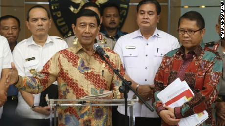 Indonesian Coordinating Minister for Politics, Security and Law Wiranto announces the presidential decree on July 12.