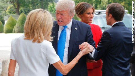 French President Emmanuel Macron (R) welcomes US First Lady Melania Trump (2nd R) while his wife Brigitte Macron (L) welcomes US President Donald Trump (2nd L) outside the Army Museum during a ceremony at Les Invalides in Paris, on July 13, 2017.  / AFP PHOTO / POOL / Michel Euler        (Photo credit should read MICHEL EULER/AFP/Getty Images)