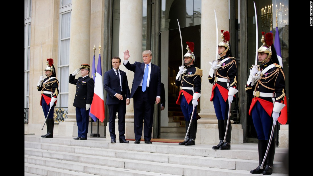 President Macron welcomes Trump before their meeting at the Elysee Palace.