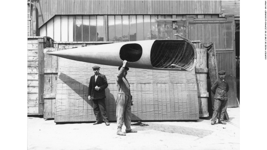 Almost all early airplanes were made out of wood, such as this complete Deperdussin Monocoque fuselage carried by workmen at the Paris Deperdussin factory in about 1912.