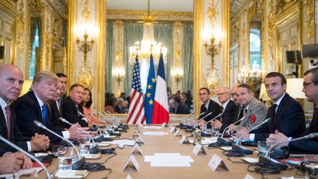 The leaders sit across a table at the Elysee Palace.