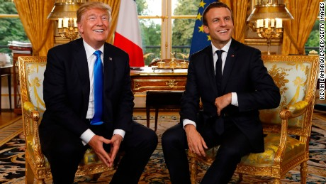 French President Emmanuel Macron (R) and US President Donald Trump (L) smile during their meeting at the Elysee Palace in Paris on July 13, 2017. / AFP PHOTO / POOL / KEVIN LAMARQUE        (Photo credit should read KEVIN LAMARQUE/AFP/Getty Images)
